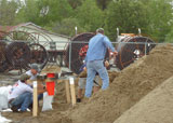 Murtco, Inc. employees filling sandbags to protect homes and businesses from flooding in Paducah, Ky.
