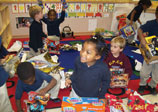 Children playing with toys they received thanks to Flatiron's nationwide giving campaign.