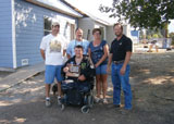 Marine Lance Corporal Parker in front of his newly renovated home, which was made wheelchair accessible.