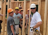 Turner Construction employees, along with local high school students, at work on their Habitat for Humanity house project.
